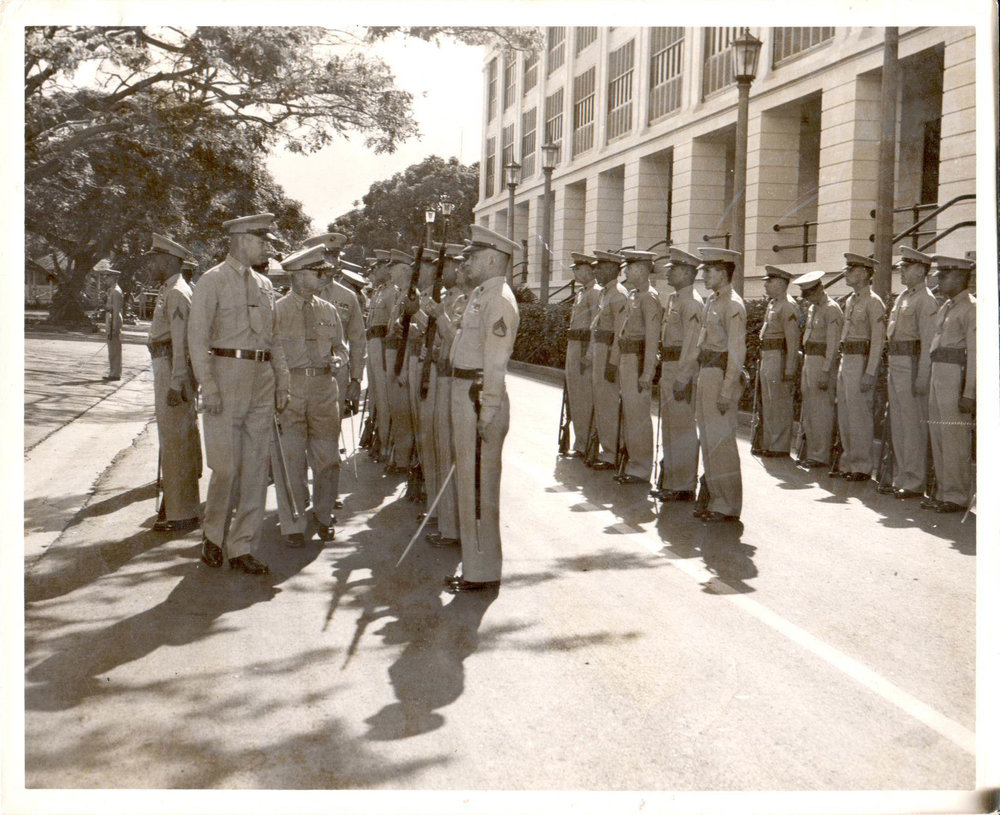 "Taken in 1958, this photograph is of Grandpa Bill, Marine Corps Captain stationed at Pearl Harbor in 1958. As my mother explained in an email, Grandpa is not saluting, he is ""reviewing the troops."" - Julia Elizabeth Evans"