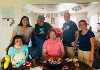 Top Row: Elaine (group home administrator), Wayne (resident), Robbie (Respite guest), Janette (caregiver)  Second Row: Rebecca (resident), Daniel (resident)