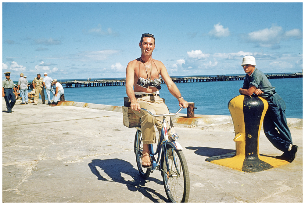 Slim Aarons,  Self Portrait Riding Bike in Hawaii,  1955