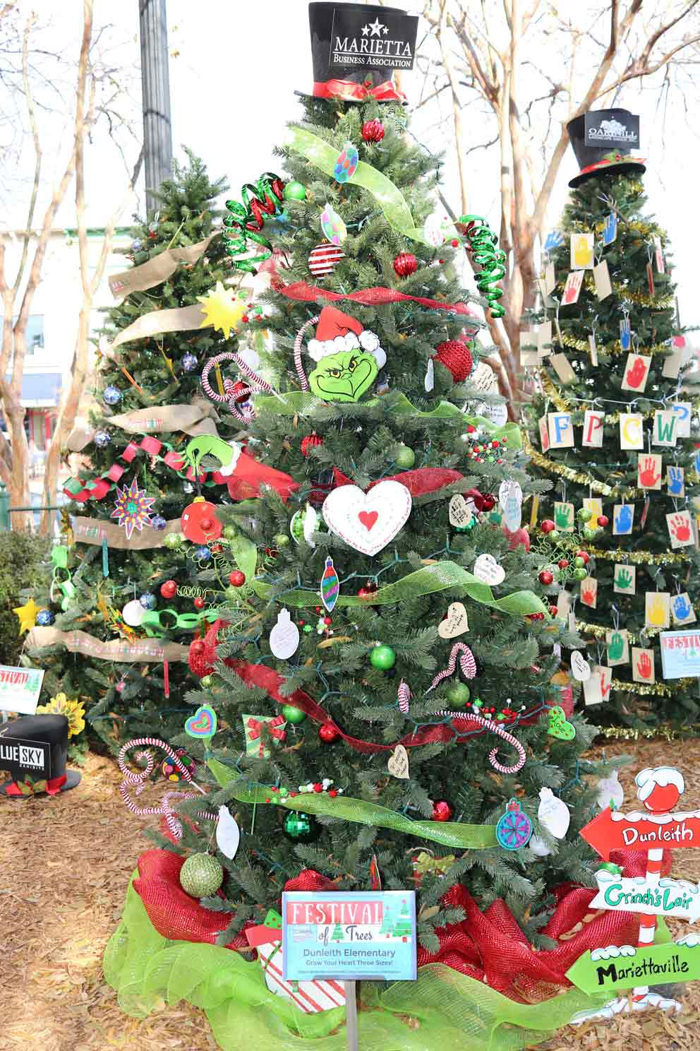 Dunleith Elementary    Created by:  Dunleith Dolphins   Theme:  Grow Your Heart Three Sizes!   Inspiration:  Spreading kindness is a cinch so don't be a Grinch! Please look carefully around our tree! Our Dunleith Dolphins have words of inspiration to help your heart grow three sizes!