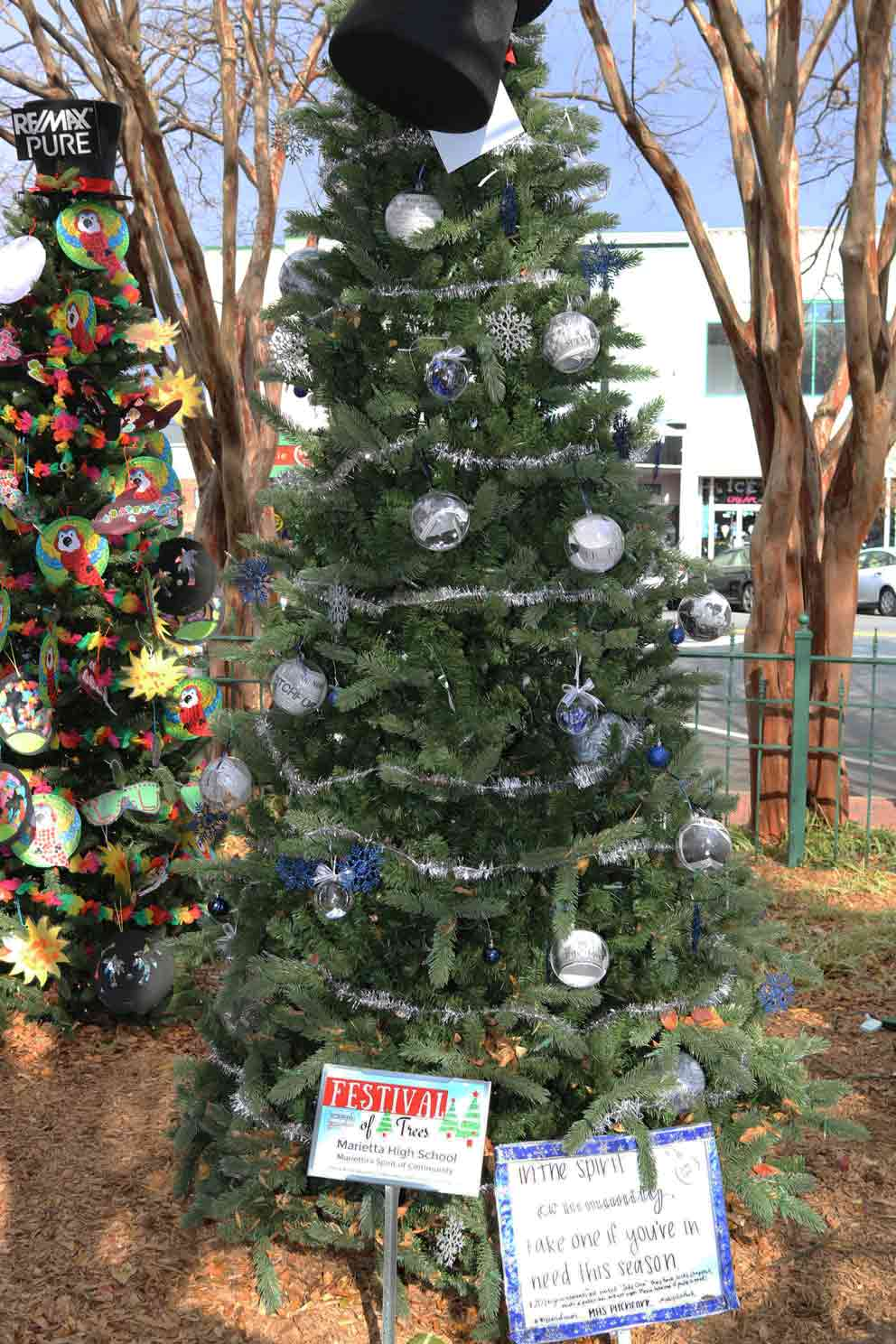 Marietta High School    Created by:  The Pitchfork Newspaper Staff   Theme:  Marietta's Spirit of Community   Inspiration:  To celebrate Pitchfork's 90th anniversary, our tree highlights Marietta's spirit of community through sharing special moments and people from the past and present. We hope our tree will inspire the magical spirit of the season by remembering the connectedness of our community.