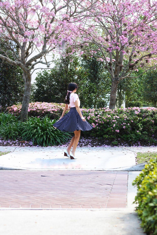 twirling she in polka dot skirt.jpg