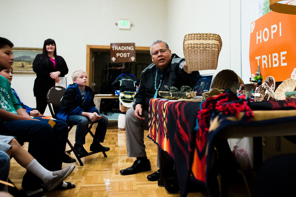 Brian Yazzie show products of the Hopi Tribe to students on November 6, 2017. Yazzi and other presenters gathered to educate students about Native American culture. (Photo by Savannah Hopkinson, special to the Daily Herald)
