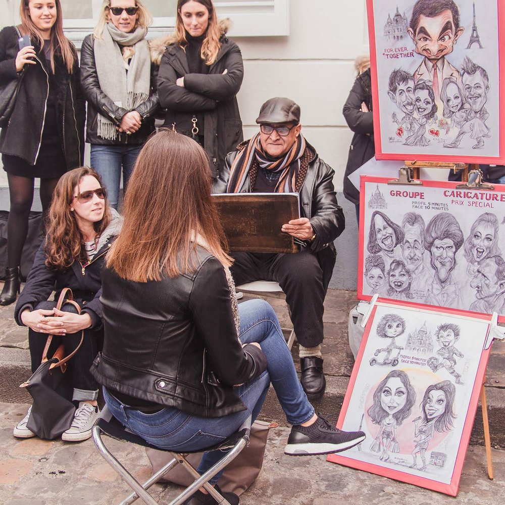 Caricaturists sit alongside portraitists in the bustling Artist's Square near the Sacre Coeur.