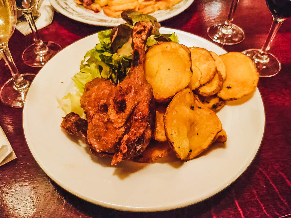 Mouth-watering confit de canard, pommes sarladaises and salade verte at Bistrot Victoires