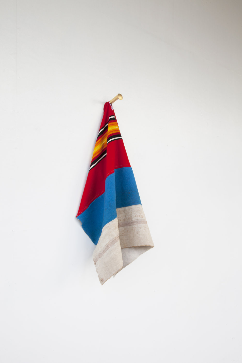 FIN (The End of the Line),  2015  Gilded Cast Iron, Pendleton Wool Selvage, Copenhagen Chewing Tobacco  44 x 19 x 7 in  Photo: Tara J Graves
