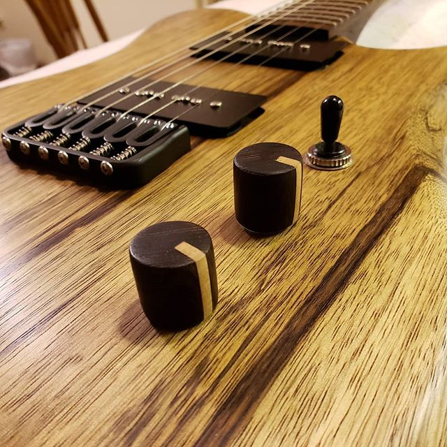 Close up of the newest Turn. Black Limba body. Wenge knobs with a Maple stripe. Made to match the Wenge fretboard with Maple inlay.  #6string #guitar #guitarporn #guitarplayer #electricguitar #guitare #guitarra #guitarspotter #guitargear #guitartune #gtr #guitarworld #guitarsofinstagram #premierguitar #guitarpost #instaguitars #guitargeek #guitarlife #makersgonnamake #musician #music # woodworking #woodporn #handmade #handcrafted #newhampshire