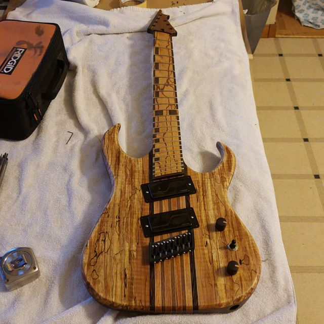 Assembling a custom Burn multiscale #7string tonight. Screws in the pickup rings, drilling for strap locks, installing tuners, a little wiring and that's a wrap!  #6string #guitar #guitarporn #guitarplayer #electricguitar #guitare #guitarra #guitarspotter #guitargear #guitartune #gtr #guitarworld #guitarsofinstagram #premierguitar #guitarpost #instaguitars #guitargeek #guitarlife #makersgonnamake #musician #music # woodworking #woodporn #handmade #handcrafted #newhampshire