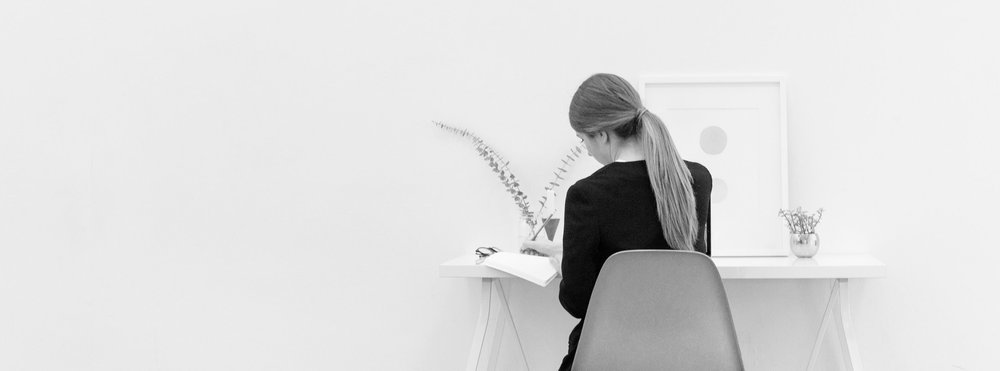 BW - WOMAN WORKING WITH WHITE WALL.jpg