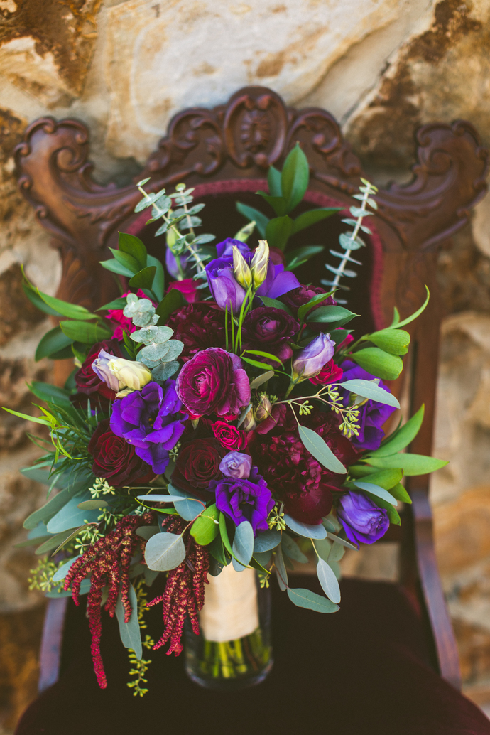 The jewel-toned bouquet, created by  Flowers by Lesley  looked stunning against  Marie  and  Madonna .