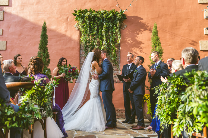 The couple's ceremony was so romantic and designed with greenery, candles and geometric shapes. We still can't get over how stunning her Blue by Enzoani dress was.