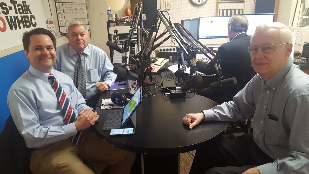 L-R: Health Matters program hosts Brad and Paul White, pharmacists talk with Jim Fidler, vice chairman of the board of governors for the Children's Dyslexia Center of Canton.