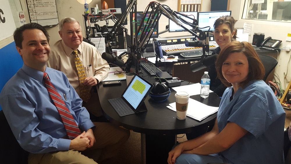 L-R: Brad White, R. Ph. and Paul White, R. Ph. discuss women's heart health with Mercy Heart Center's Kim Swast, RN and Michelle Amos, RN, MSN.