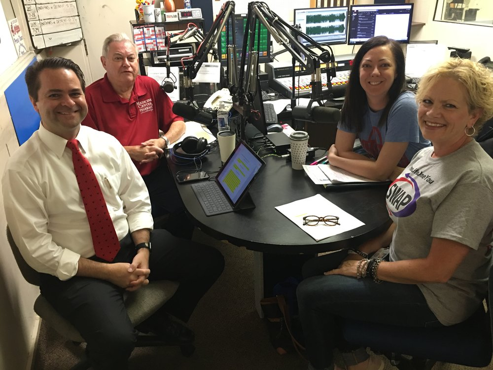 L-R: Pharmacists Brad White and Paul White discuss the SWAP Syringe Exchange Program and Hepatitis A with Canton City Public Health's Amanda Archer, epidemiologist and Diane Thompson, nursing director.