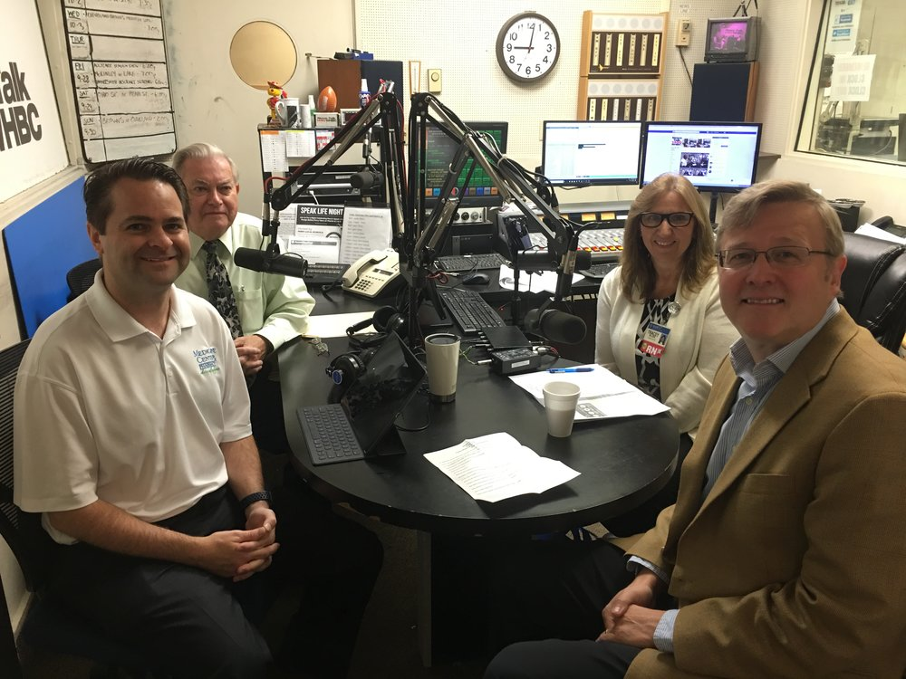 L-R: Pharmacists Brad and Paul White discuss Sepsis Awareness Month with Mercy Medical Center's Tracey Majors and Dr. Frank Kaeberlein.