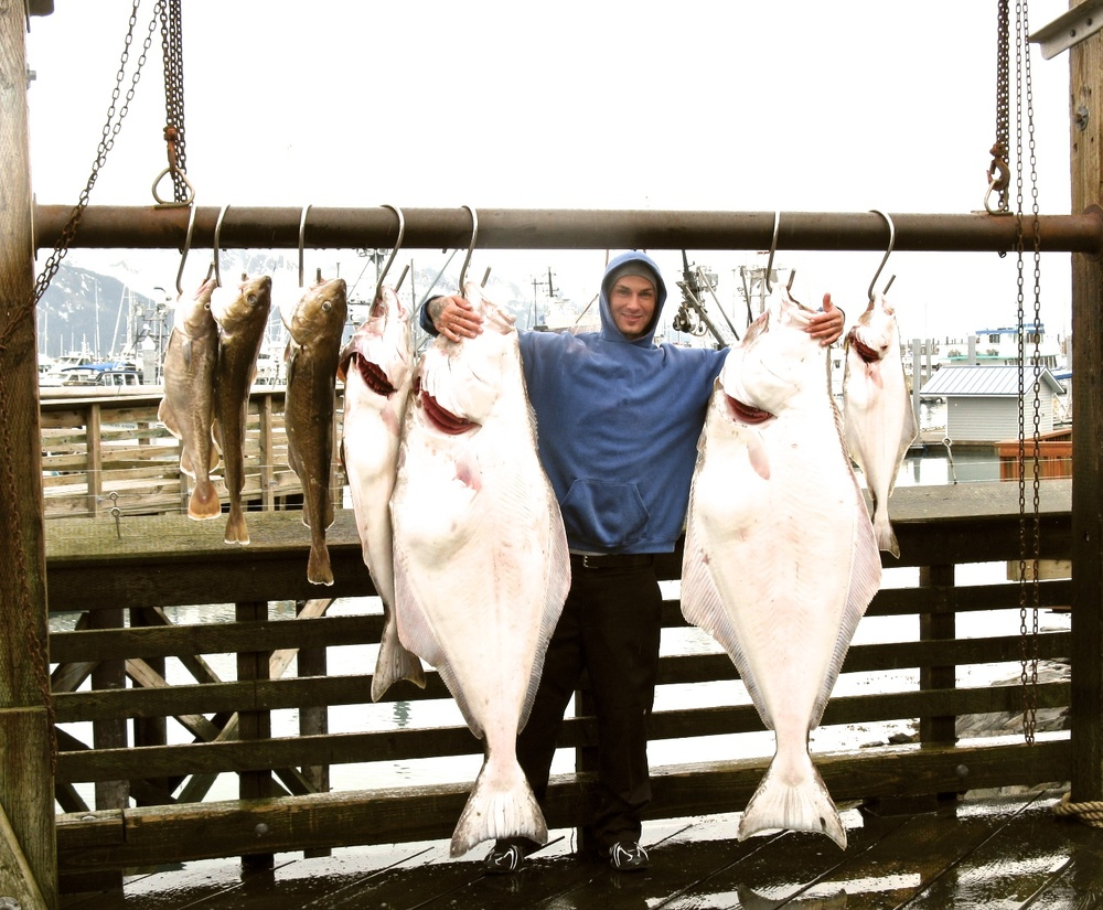 Jerald with Alaskan Halibut he caught in Seward.