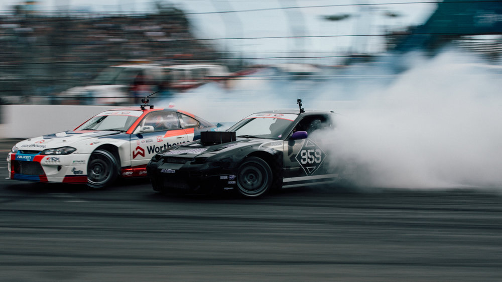 Formula Drift made its 2018 debut in Long Beach, California last weekend.  Round 1 of the 8 part series takes place on the Long Beach Grand Prix race track.  Coffman Racing arrived at the event ready to shred.  In the off season, the team made some subtle changes.  The race car wears a fresh livery, designed for the 5th year in a row by the talented Factory83. The car was fully rebuilt in the off season and is ready for another year of battle.  Our crew is all new as well. We were able to recruit a few talented mechanics that spent the past few years working on rally car teams.  We also have a new crew chief and spotter this season that is very experienced with professional drifting.  We are confident this is the best version of our team to date.