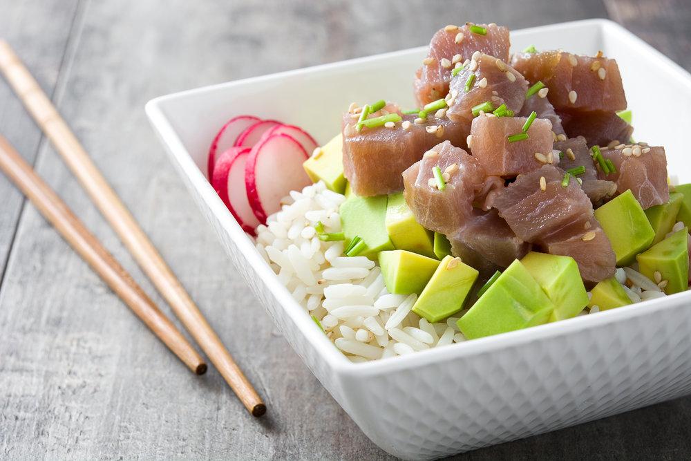 Hawaiian tuna poke bowl with avocado, radishes and sesame seeds