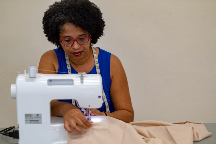A seamstress demonstrates her talent in a business incubator project.