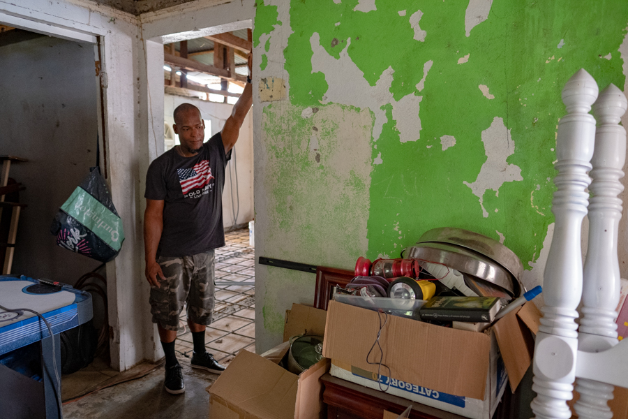 A father surveys the work ahead in renovating his home...one year after Hurricane Maria