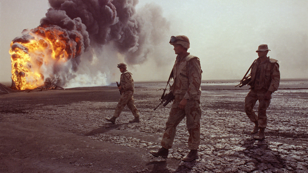 An actual photo from the First Gulf War in 1991. Printed with newspaper ink in CMYK, this image would be even more washed out and higher contrast. Three Kings resembles images like this despite being entirely shot in America.