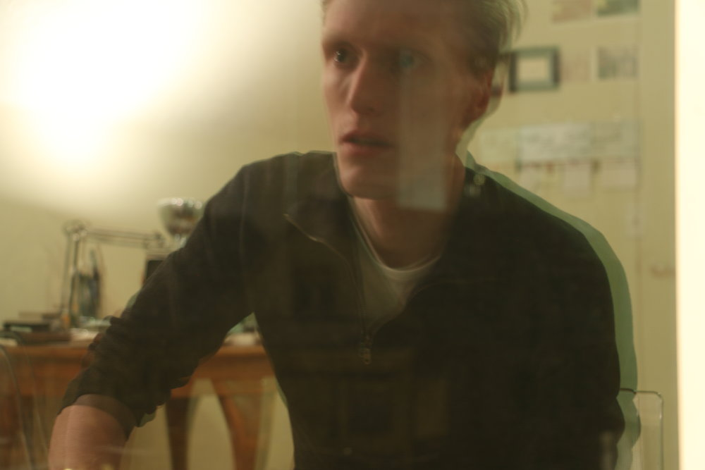 I used my camera and the window in my room to photograph a self portrait of dissociation and anxiety on February 8, 2016.