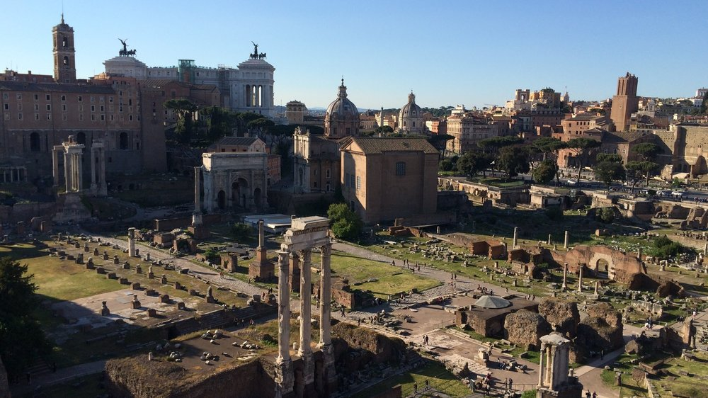 The center of Rome is still clear and awe inspiring to people today. It's the sort of uniquely designed locus of a world class city baked under so much time in the sun. It is remarkable to stand in the place where Caesar was killed.Shot on an iPhone 5s.
