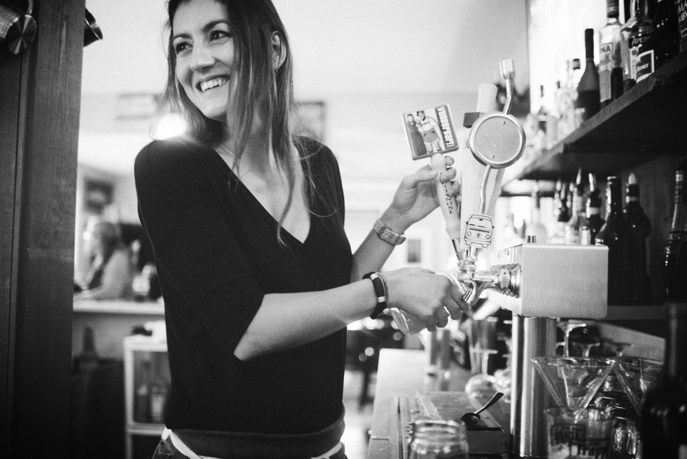 Salt & Honey's Bartender /// Special Event Manager Kara Picone serving local craft beer on tap at the restaurant in Kennebunkport, Maine.