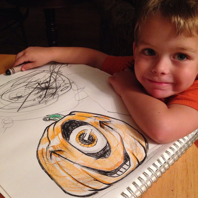 Designing our Halloween jack-o'-lanterns before we carve and paint.