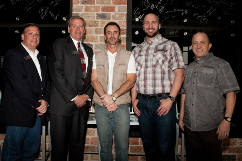 Owners Adam Smith and Neil Noble photographed with Mayor Jim Griffin and Harley-Davidson executive Christian Walters