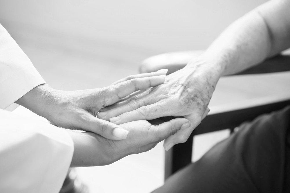 senior-woman-talking-with-black-doctor-in-hospice-PQRFRSD.jpg