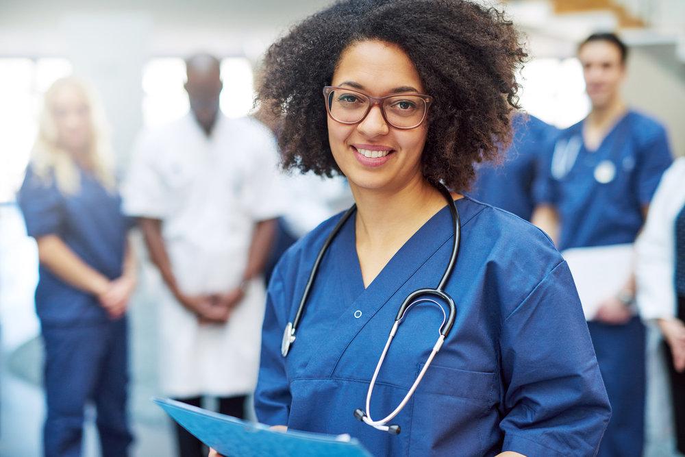 pretty-black-doctor-standing-in-the-clinic-JCU8YTG.jpg