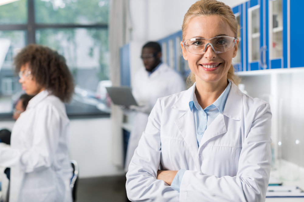portrait-of-smiling-woman-in-white-coat-and-3K28UQS.jpg