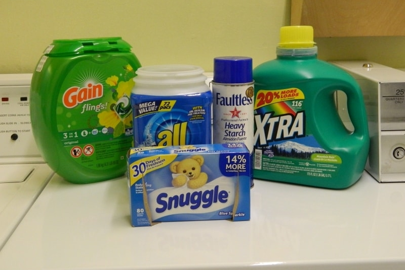 Detergent, fabric softeners, bleach, starch, iron, and ironing board are all provided.