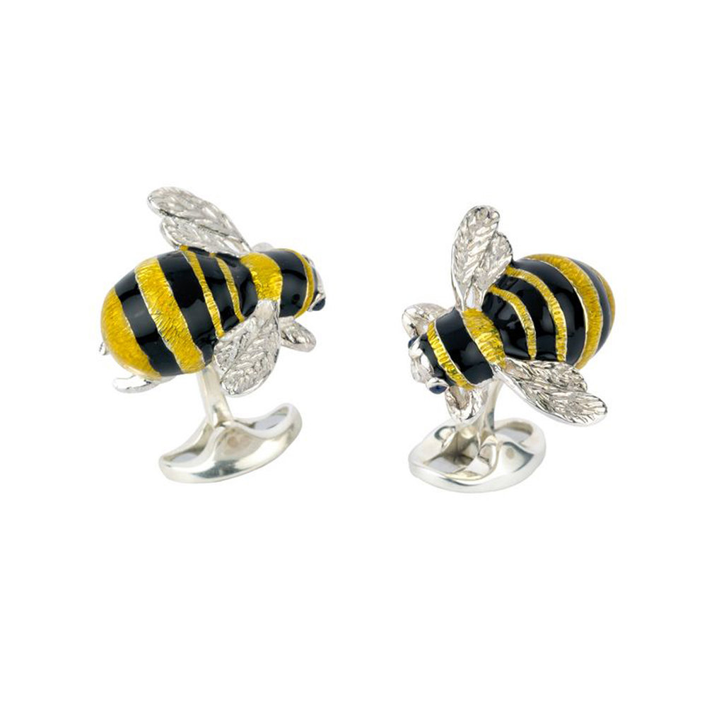 A familiar feature of the English countryside garden, the bumblebee's bright colours were the inspiration behind this fantastic set of cufflinks. The vibrant black and yellow enamel detail combined with the brilliantly set cabochon sapphire eyes make these bumblebee cufflinks the perfect accessory to create a buzz around any outfit.