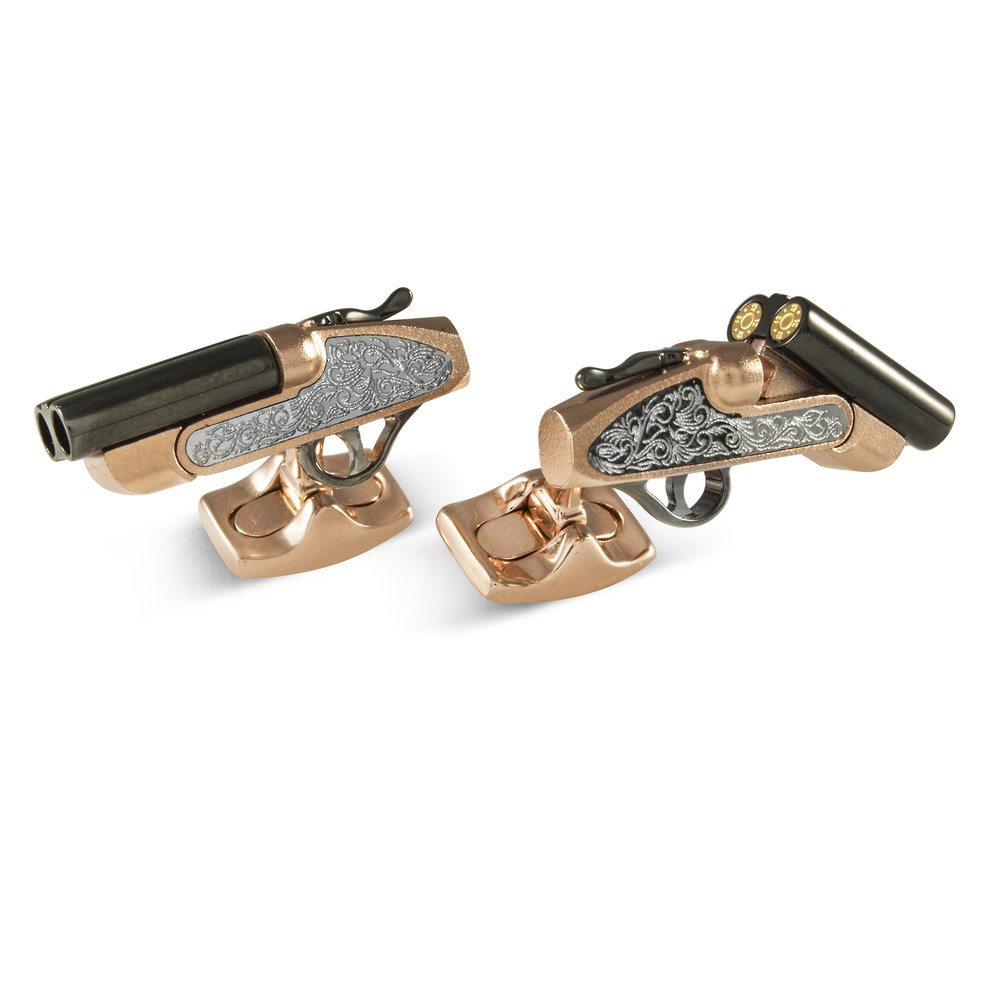 You will be right on target with these quintessentially English, 12 bore shotgun cufflinks!       With detailed side lock engraving, you can even spring the lever and watch as the repelling magnets open the barrels to reveal the stunning gold cartridge caps. When you aren't guns blazing, the barrels click firmly shut. With beautiful rose gold outer and black rhodium barrels you will be lock, stock and two smoking barrels with these on your sleeve!