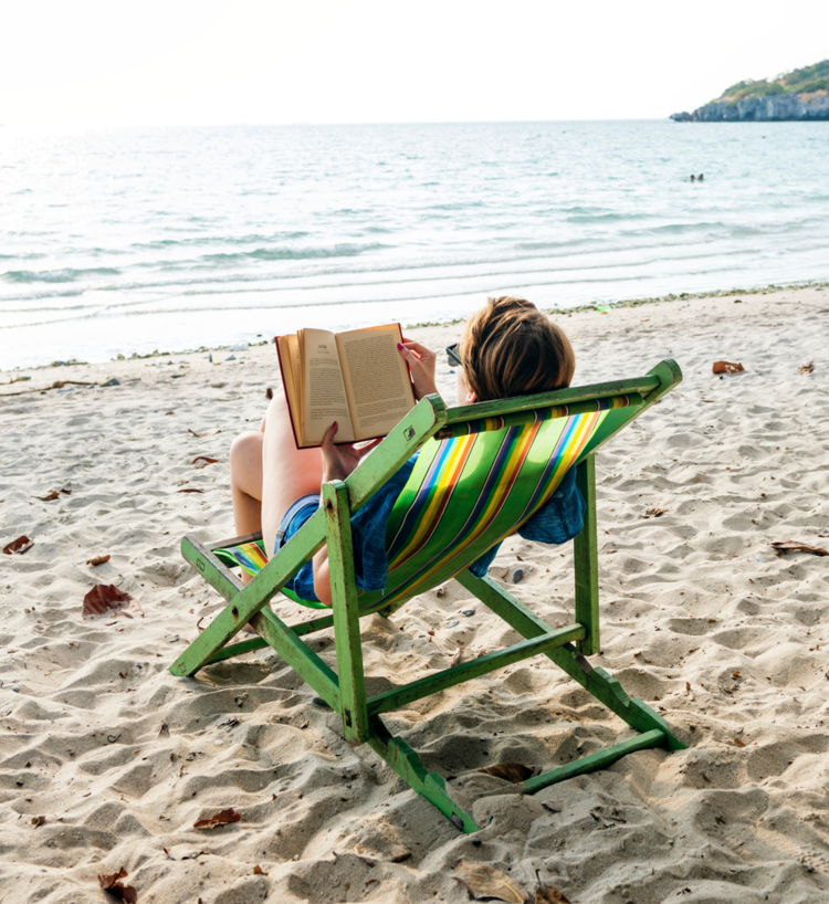Reading on the beach.