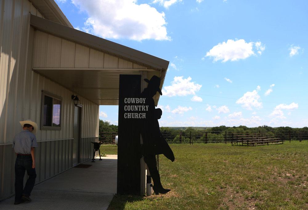 Alex Parker, 11, of McFarland, Kansas walks into the Cowboy Country Church.