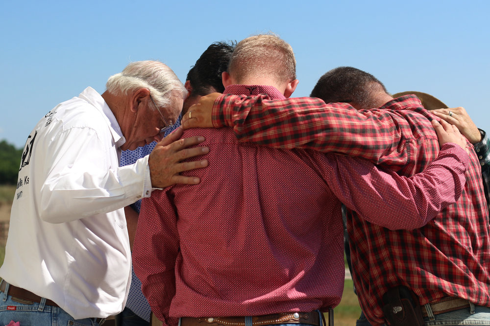 Don Blanka, left, prays with the male members of the church before the morning sermon at the Cowboy Country Church in Wamego, Kansas.