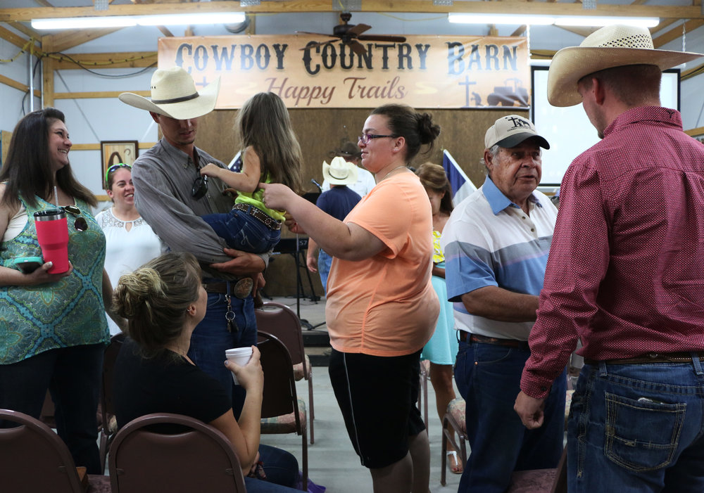 Members of the Cowboy Country Church gather after a service.