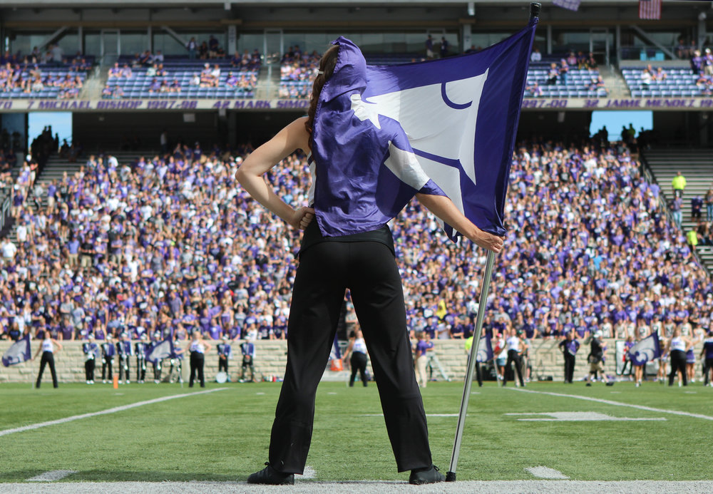 A member of the Wildcat Band stands with a flag before the game against Baylor University at the Bill Snyder Family Football Stadium on Sept. 30, 2017.
