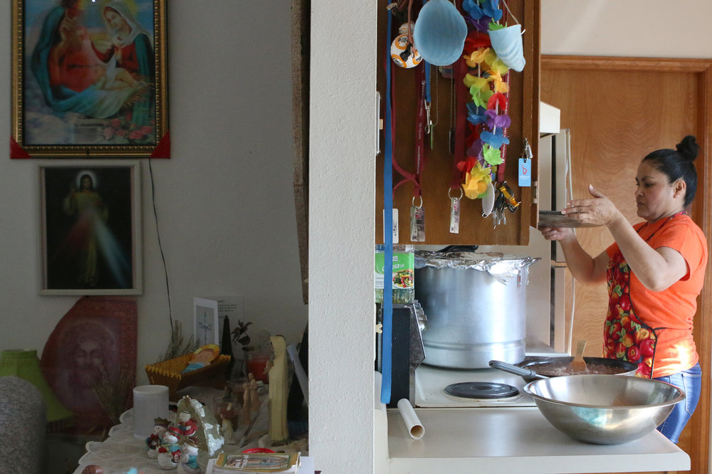Maria Olague replaces the lid on a pot of tamales in her home on Dec. 4, 2017. Story: http://bit.ly/2CknWcA