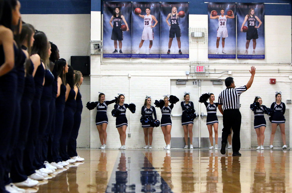 Dancers and cheerleaders line up at a game at Manhattan High School on Jan. 5, 2018.