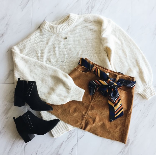 via Pinterest  Sweater (similar):  https://www.forever21.com/us/shop/catalog/product/f21/branded-shop/2000315482   Skirt (similar):  https://www2.hm.com/en_us/productpage.0650682004.html   Black Booties:  https://www2.hm.com/en_us/productpage.0514157001.html