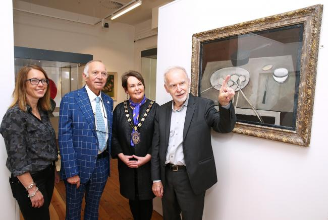 At the opening reception (left) Stella Byrne, Heritage Lottery Fund; Robert Scott; Councillor Mary Garrity, Chairperson of Fermanagh and Omagh District Council; James Scott