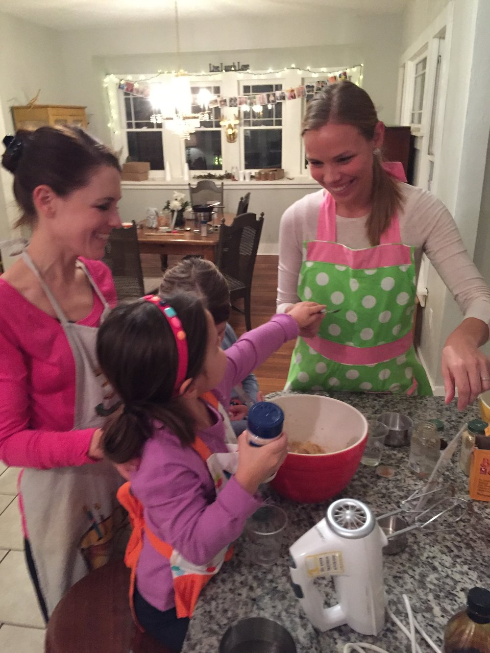 Moms and Daughters making some gingersnaps!
