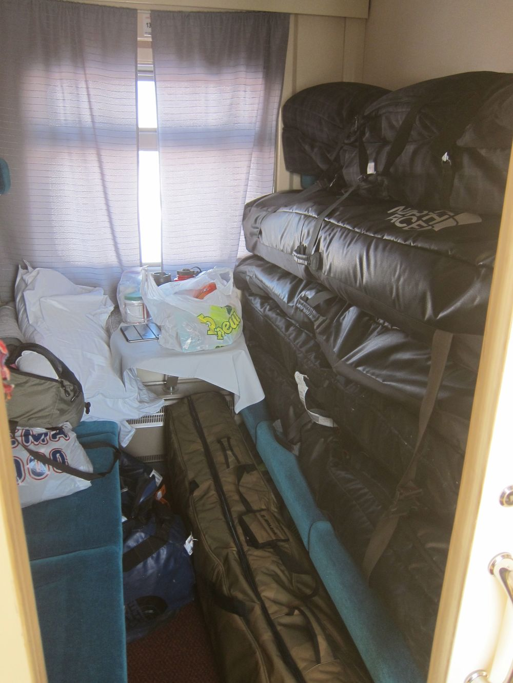 "My ""home"" for several days and nights on the train.  I barely slept for fear that this sketchy tower of our ski bags was going to topple over on me as the rickety train swayed and lurched back and forth all night."