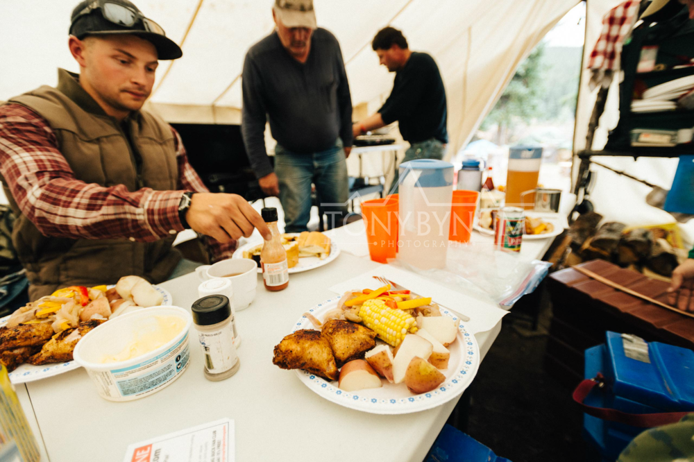 Food is ready for hunters inside a wall tent in a remote hunting camp in the rocky mountains. © Tony Bynum