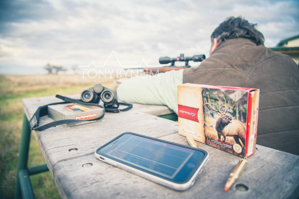 A hunter sighting in his rifle with Norma Ammunition, and the Iphone app. © Tony Bynum