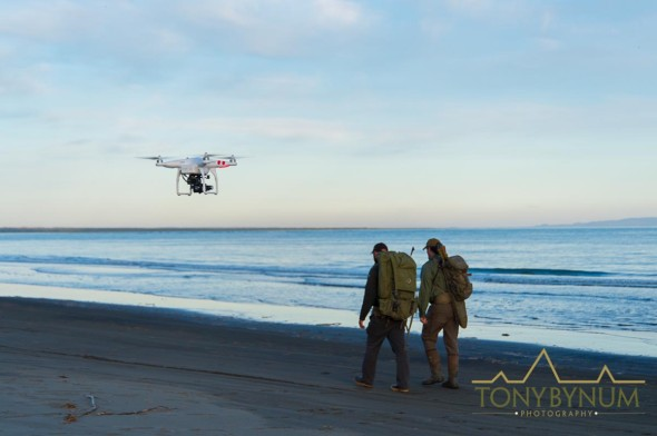 drone filming two men on beach
